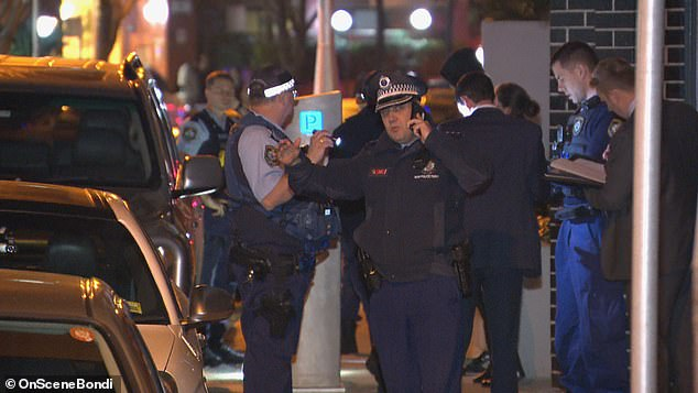 Pictured: police at the scene of the attack in Sydney
