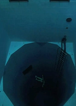 The astonishing video sees the 29-year-old plunging, without any breathing equipment whatsoever, a staggering 33metres to the bottom of the NEMO 33